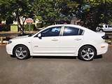 2005 Mazda3 Sp23 Bk Sedan Auto White 1475 Side Passenger