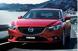Sedan Is Available In 5 Different Styles I Grand Touring 4dr Sedan 2