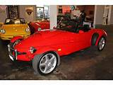 Is Pleased To Offer This 1997 Panoz Aiv Roadster In Red With